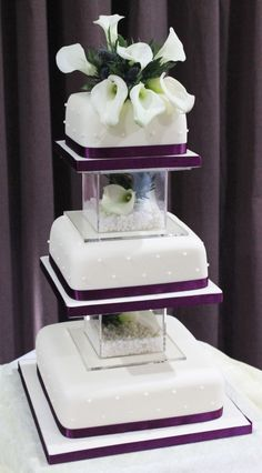 Three tier wedding cake with real lillies