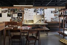 studio Mumbai Exhibit - working table 01 /Nacása & Partners Inc.  People can sit on a chair made by Studio Mumbai and look through the sketchbooks and photo books on the table.