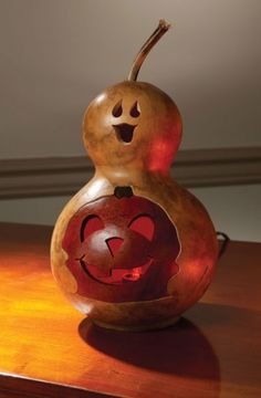The natural colored Spooky Boo comes in two sizes with a pumpkin in the belly. All come with an electric light. The small Spooky Boo is approximately 5