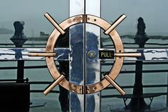 Nautical door handles with ship wheel design. Fisherman's Wharf, San Francisco, CA. #doors #shipwheels