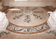 Custom bath floor medallion with vine accents.  -photo courtsey of Michael Golden