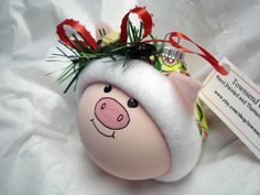 "Nursery Rhyme Pig Ornament Christmas Tree Bulb  Hand Painted Glass Themed with""This Little Piggy"" -  Personalized. $16.95, via Etsy."