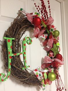 Whimsical Monogrammed Christmas Wreath - Christmas Wreath - Red & Green Christmas Wreath - Grapevine Christmas Wreath. $55.00, via Etsy.