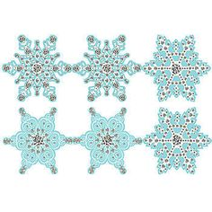 Our Snowflakes and Diamonds Cut Out Set feature white snowflakes with silver accents in a variety of different designs on a light blue background.
