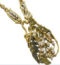 Lalique - 1900 'Wisteria' Longchain Necklace: 62 cm of alternating links and a central pendant featuring wisteria decorated floral and leaves motif.  sothebys.com