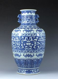 """A Large Chinese Blue and White Archaic Dragons Porcelain Vase.  Having baluster shaped body, two dragons flanked to the neck. Archaic geometrical patterns resembling facing twin dragons. Marked on base, six blue script -ZhuanShu- characters, QianLong Reign Period of Great Qing 18-1/8""""H x 9""""W"""