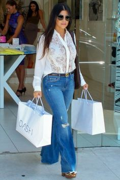 Kourtney Kardashian wearing Bottega Veneta Woven Bag, Gucci Morena Platform Mules, Fendi Baguette Micro Leather Shoulder Bag in Mint, Mason by Michelle Mason Silk Lace Front Blouse and McGuire Majorelle Flare in Oceana with Rips
