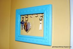 old picture frame to hold keys! we could label each spot too
