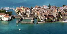 Sirmione, Lake Garda ~ An Italian castle surrounded by a lake