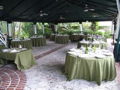 Tables under the canopy set for wedding dinner and reception at the Historic Stranahan House Museum