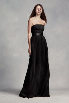 dec22533ce A floral lace underlay peeks through airy tulle on this long strapless  bridesmaid dress