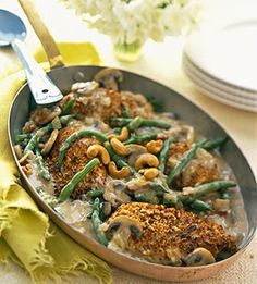 Cashew-coated chicken breast halves cook with green beans and bacon in a savory mushroom sauce. It's a weekday dinner your family will love.