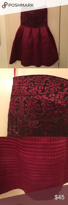 Strapless bandage fit and flare dress Maroon and black patterned top. Solid maroon bottom. Bandage material. Super comfortable. Great for formals. Only worn once! Dresses Strapless