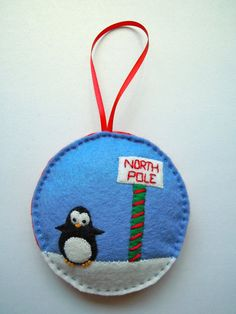 Geographically challenged penguin Christmas tree ornament
