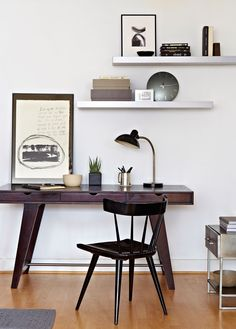 A small home office was set up next to the front door, under a set of metal shelves that already existed in the apartment. The ebony desk was purchased at a Brooklyn flea market.