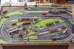 N gauge duel track running two trains and offshoot to station with plenty of switches