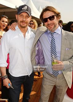 Tom Hardy (L) and Jay Kay attend day one of the Audi Polo Challenge at Coworth Park on May 28, 2016 in London, England.