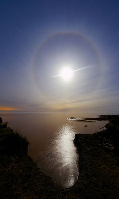 A powerful and colorful 22 degrees lunar halo as seen from Punta Piedras in the coast of Rio de La Plata, Argentina on june 2013.