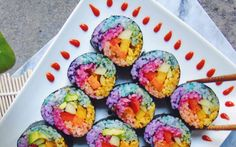 A true feast for the eyes, the vibrant rice in this sushi is colored naturally with ingredients like turmeric, beet powder, spirulina, and purple cabbage.