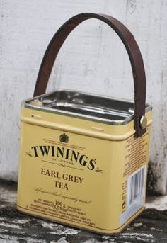 twinings can Supplies:  Tea tin - easy to find at thrift stores  Strip of leather - I used an old belt  2 Brads  Small Hole punch  Hammer and one nail
