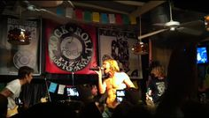 Taylor Hawkins (drums) and Chris Shiflett (guitar) of the Foo Fighters at Rock & Roll Pizza at the Rack in Woodland Hills, California