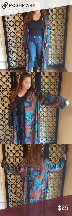 MULTICOLORED FLORAL KIMONO ROBE Excellent vintage condition. No flaws.  Jaclyn Smith. Size 2X.  Beautiful colors of teal  blk  holds pinks  purples  blues.  14 inch deep v neck. Has tie but I would wear it out as a long kimono or as a robe at home! 3 inch blk lace along the front and along the bottom as well as sleeves.  51 inch length and sleeve length is 25 inches. Jaclyn Smith Intimates & Sleepwear Robes
