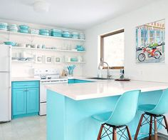 This homeowner transforms her space into an aqua and white retro-inspired kitchen.