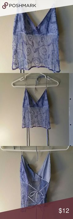 Beaded Mesh Halter Rue 21 beaded Halter top. This was my favorite for clubbing! The back has two ties and the neck is tied as a halter. Blue mesh with purple beading embroidery. If only I still had a figure for this! Would look awesome with a pair of white skinny jeans! Rue 21 Tops Crop Tops