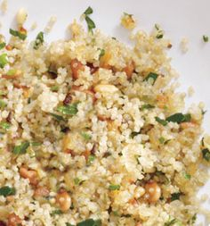 Quinoa Pilaf with Pine Nuts    1/2 cup quinoa  1 cup low-sodium chicken broth  2 teaspoons olive oil  1/2 large onion, chopped  2 tablespoons pine nuts, toasted in a dry skillet over medium-high heat until golden brown, 2 minutes  2 tablespoons fresh parsley, chopped