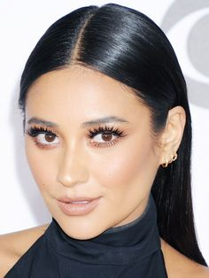 Shay Mitchell shows how do to a high-shine center part