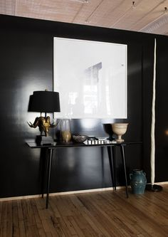 The apartment, Soho: black wall and really cool lamp