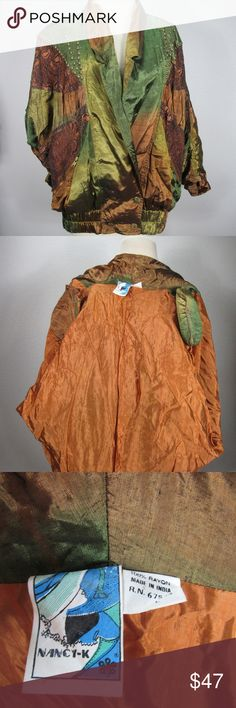 """VTG Nancy K Metallic Copper Shiny L Coat 80s 90s Holy Moses you've just found the most amazing retro/80's/90's/vintage coat/jacket/windbreaker out there! Beautiful copper and green/gold gradient coloring with funky designs and rivet accents. Jacket is in excellent condition with no flaws or notable wear!  Bust: 52 Waist: 44"""" Pit to Pit: 26"""" Shoulder: 21"""" Length:26"""" Arm hole opening: 8"""" Nancy K Jackets & Coats"""