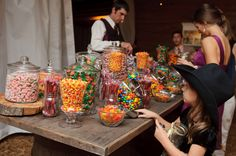 Yummy rustic candy bar - mason jars act as take home containers!