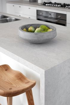 Topus Concrete 4023 by Caesarstone quartz countertops feature rich shades of buttermilk on a cream-toned base creating a multi-layered effect. Stone Benchtop Kitchen, Concrete Kitchen Counters, Kitchen Island Bench, Stone Kitchen, Stone Countertops, New Kitchen, Concrete Bathroom, Bathroom Faucets, Kitchen Stuff