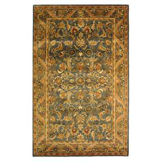 Stylishly anchor your dining set or living room seating group with this hand-tufted wool rug, showcasing a Persian motif in blue and gold.