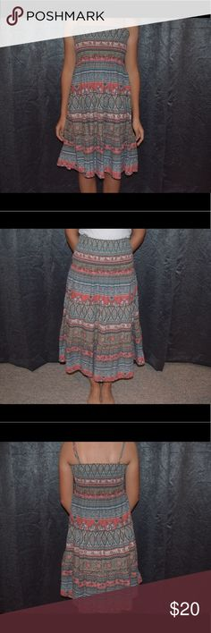 Patterned Midi Sundress / Maxi Skirt This is one of my favorite dresses and is very well loved. It is a little longer than knee length and comes with detachable straps so it can become strapless. You can also take the straps off and wear it as a maxi skirt. The top part is very stretchy so I'm sure it can fit most sizes; it fits me great and I'm 5'4 and 125 lbs. I've had it for a while so I'm not so sure where it came from, and the tags have been cut off. Dresses Midi