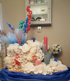 Coral reef from coffee filters, ketchup cups, mesh and pool noodles. Coral reef from coffee filters, ketchup cups, mesh and pool noodles. Mermaid Under The Sea, Under The Sea Theme, Under The Sea Party, Coral Reef Craft, Adaline, Little Mermaid Play, Under The Sea Decorations, Coral Decorations, Shark Party