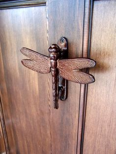 I've been obsessed with dragonflies since learning of their cultural past and toast to good health... If I had a home, I would complete it with a Dragonfly Door Knocker :)