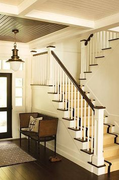 beautiful entry and staircase  |  rich dark woods contrasted with white