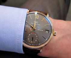 This might be a men's watch, but I'd wear it - beatiful. IWC Portofino Hand-Wound Eight Days in red gold