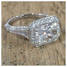 Emerald cut east-west diamond engagement ring