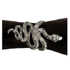 Platinum snake napkin rings with emerald eyes.