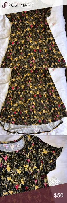 **BNWT Small Aztec Print Carly BNWT Small Aztec Print Carly....Mustard Yellow/Black/Light Pink and a Darker Pink/Red...BEAUTIFUL, but doesn't look great on me  LuLaRoe Dresses High Low