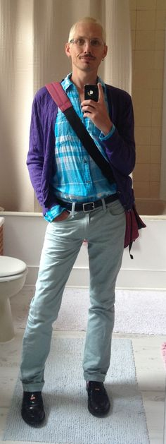 Magenta courier bag: Eastpak /Purple cardigan: River Island /Turquoise cotton cheese-cloth shirt: HM /Aqua jeans: Uniqlo /Blue patent leather belt: Paul Smith /Oxblood penny loafers: Andrea Rossi /Multi-coloured cotton socks: Happy Socks...