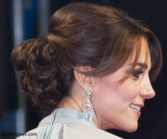 """The Duchess of Cambridge's elegant updo for her appearance at The Cinema and Television Benevolent Fund's Royal Film Performance 2015 of the 24th James Bond Adventure, """"Spectre"""" at Royal Albert Hall on October 26, 2015."""