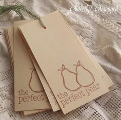 "You just got to love a good fruit pun **Wink** -- These tags measure 2 inches by 4 inches. On heavy cream colored cardstock (110lb) are two sweet little hand drawn looking pears, hand stamped in sepia brown along with the hand stamped text that reads ""the perfect pear."" They are blank on the back too making these great for wedding wish tree tags and even journaling tags. They are topped with light green / celery colored twine. I have used 12 inches of twine leaving you just about 6 inches to…"
