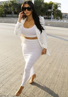 Nothing 'plane' about her: Kim Kardashian turned every head as she arrived at LAX airport on Saturday