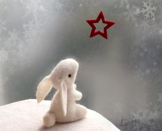 White felt mini bunny :    This little sweet bunny has its own beautiful star, so it can make a wish always!     The rabbit is hand stitched of