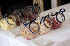 Adam and Anna had an exciting sweety bar featured at their wedding reception.  They filled glass jars with their favourite treats and tied a navy blue ribbon around the top of each jar to coordinate with their Tottenham Hotspur wedding theme. Click here to read more about this exciting real wedding.