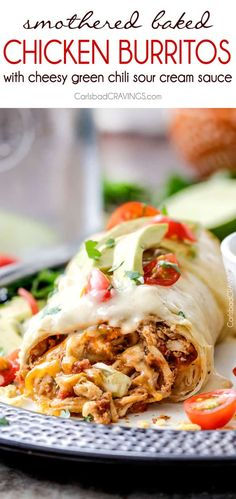 """Smothered Baked Chicken Burritos AKA """"skinny chimichangas"""" are better than any restaurant without all the calories! made super easy by stuffing with the BEST slow cooker Mexican chicken and then baked to golden perfection and smothered in most incredible cheesy green chili sour cream sauce. Sour Cream Sauce, Sour Cream Chicken, Creamy Chicken, Baked Burritos, Smothered Burritos, Smothered Chicken, Chicken Burritos, Chicken Wet Burrito Recipe, Chicken Taco Bake"""